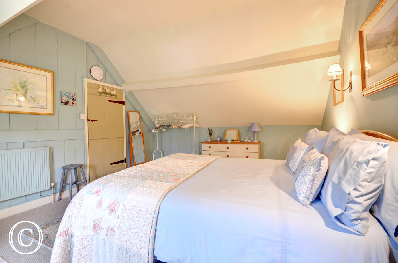The master bedroom has been tastefully decorated in a country style.