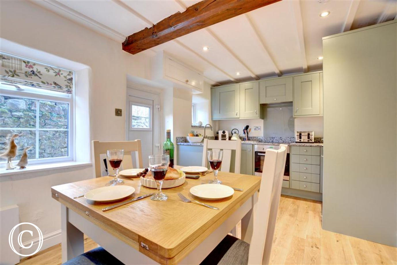 The open plan kitchen diner is ideal for a chat whilst cooking.