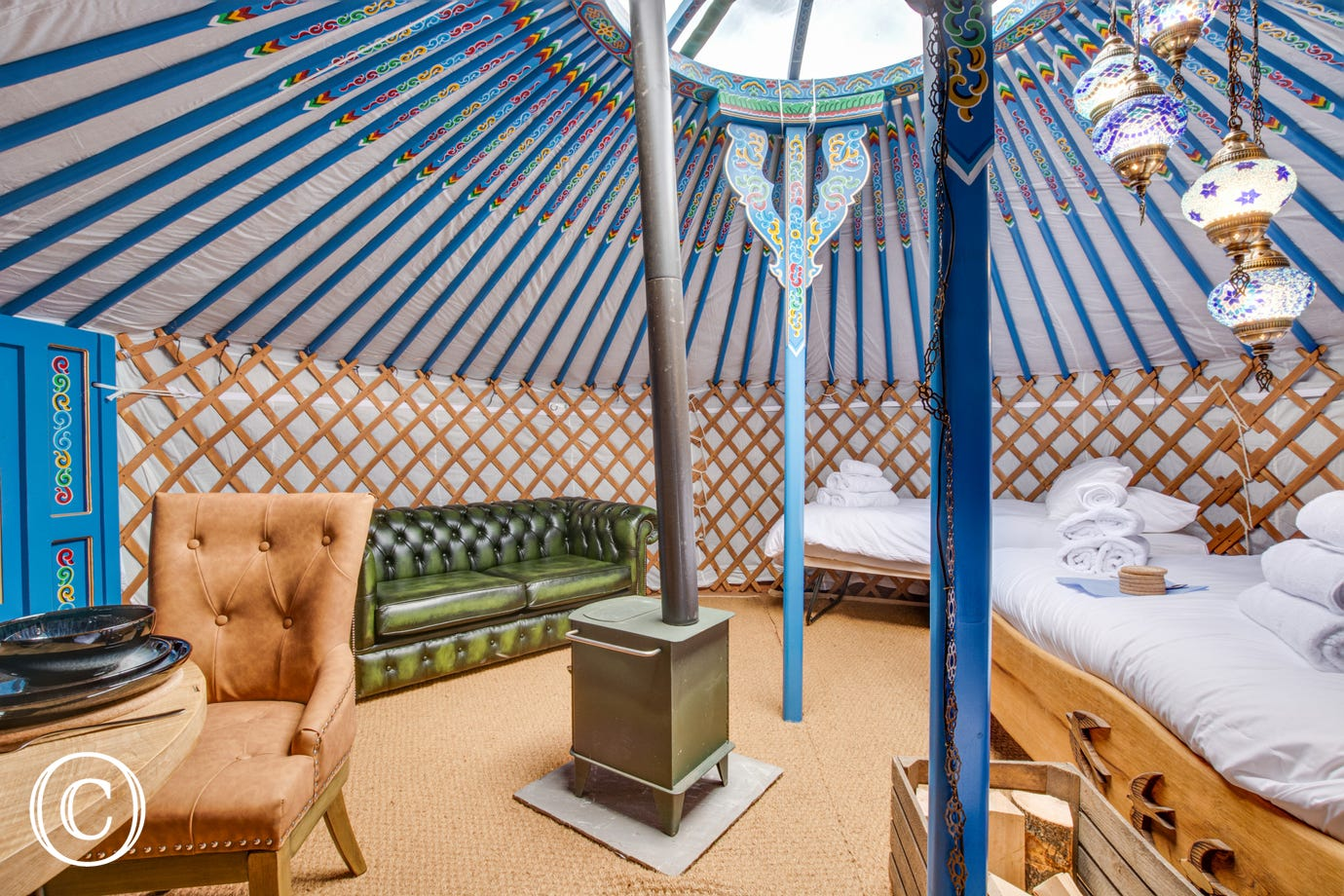 Beautiful interior of Swallow Yurt complete with woodburning stove