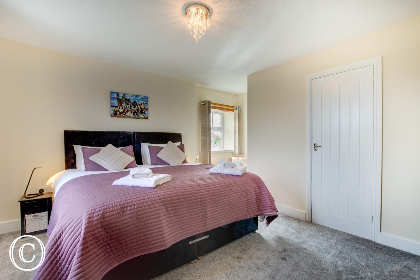 Master bedroom with Zip & Link beds and en suite shower room