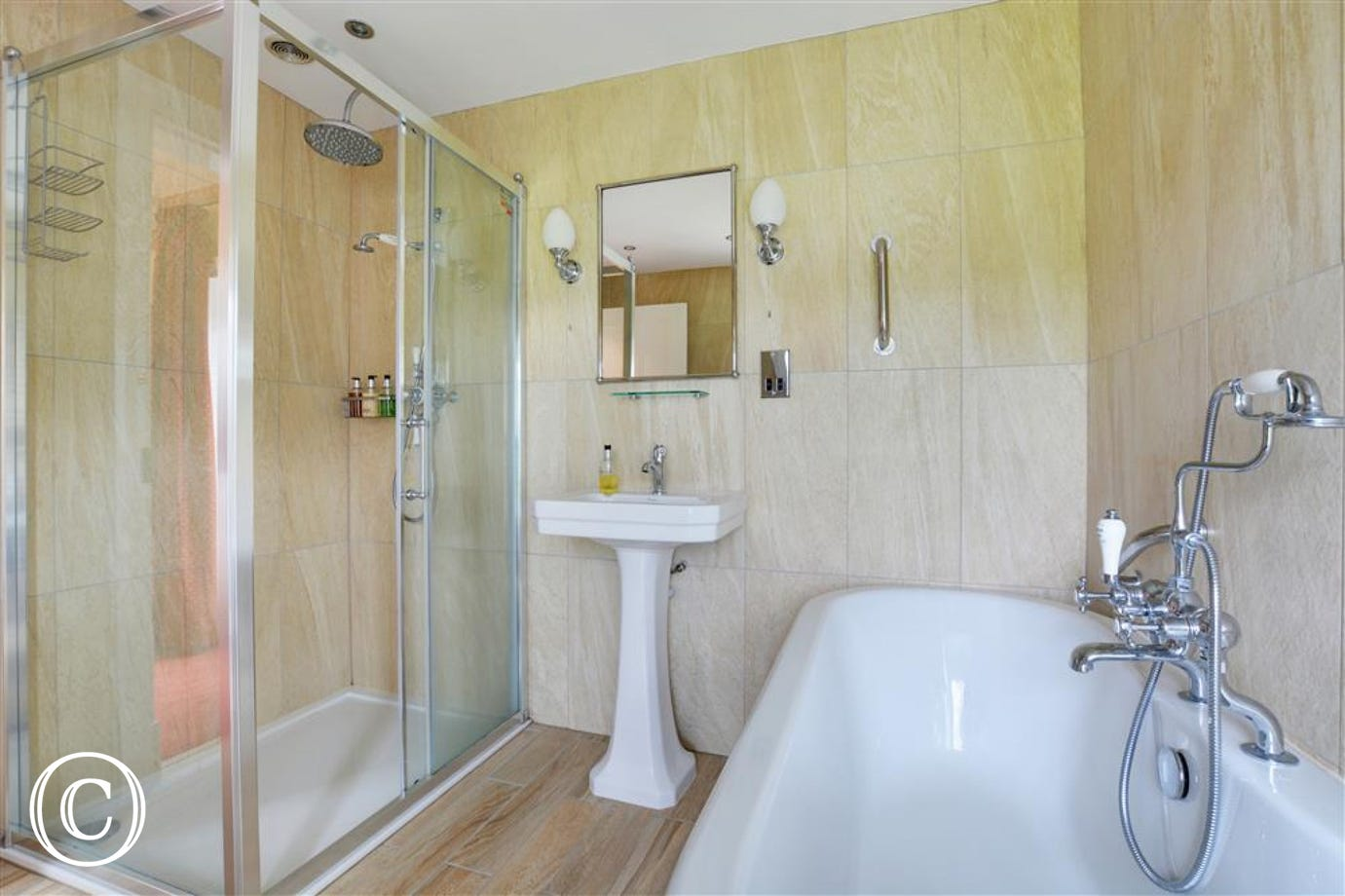 Light and airy bathroom with roll top bath and seperate shower.