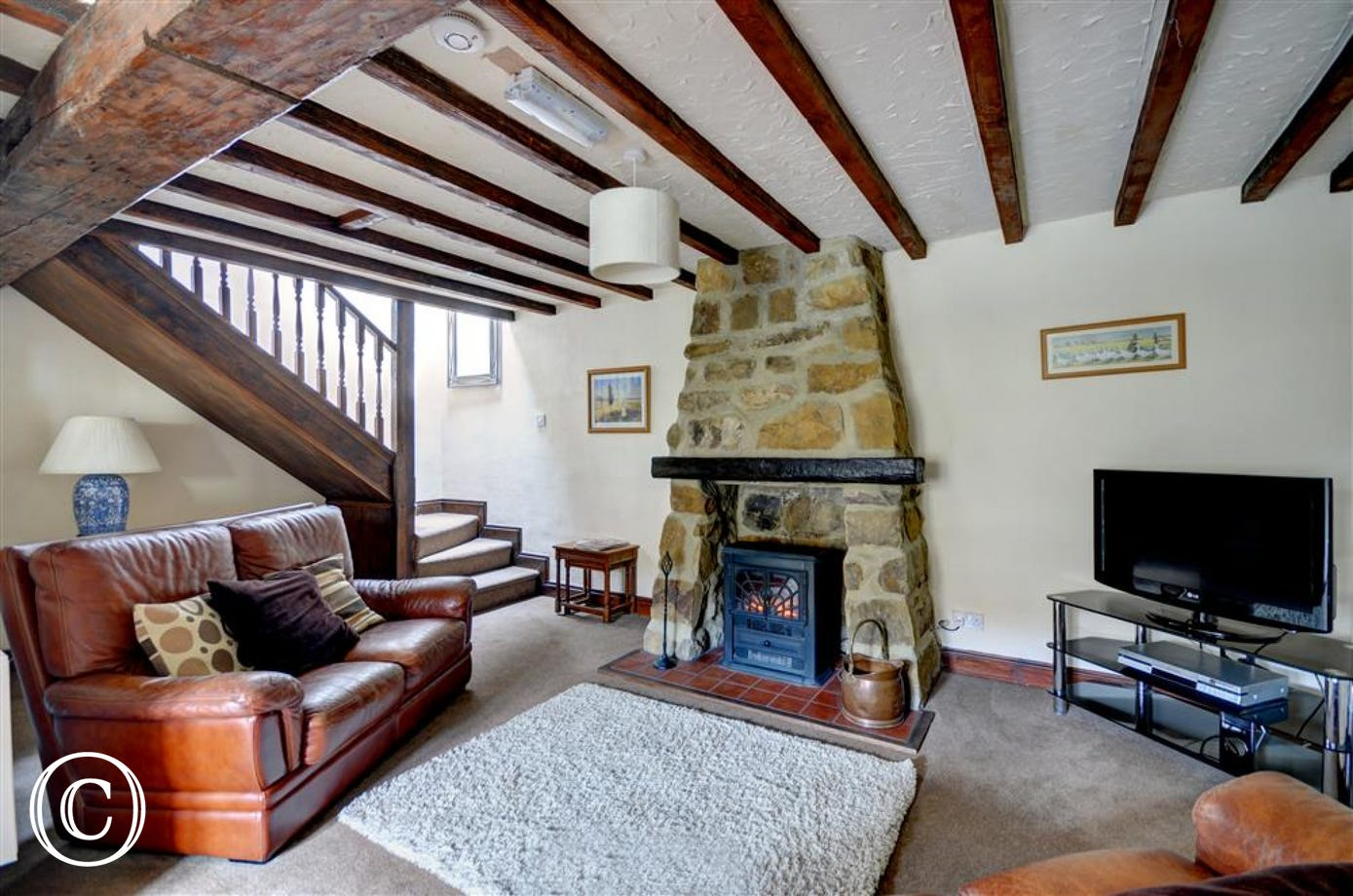 Sitting room with a lovely warm electric feature stove