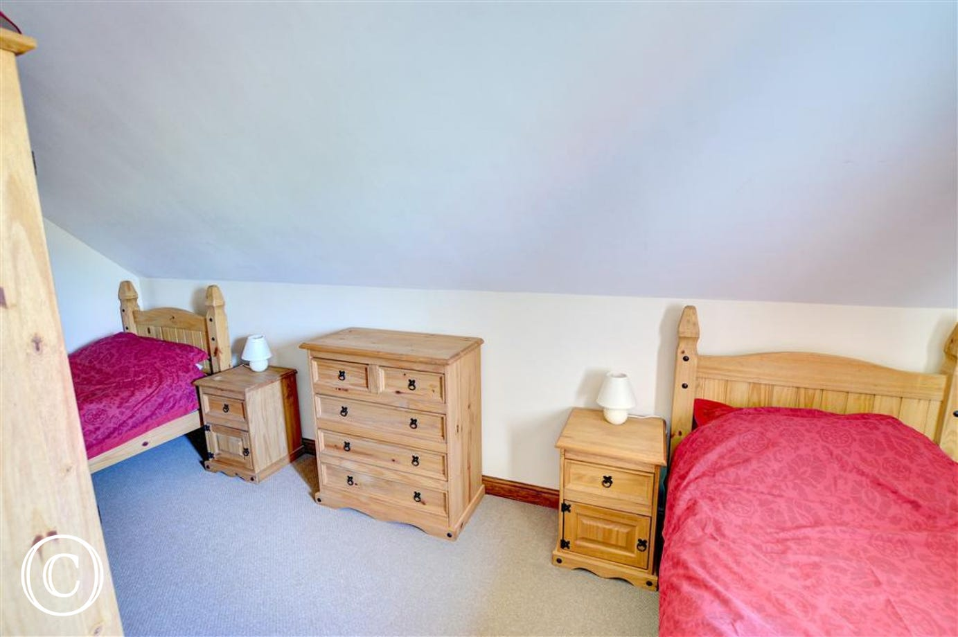 Twin bedroom offers comfortable space for both single beds.