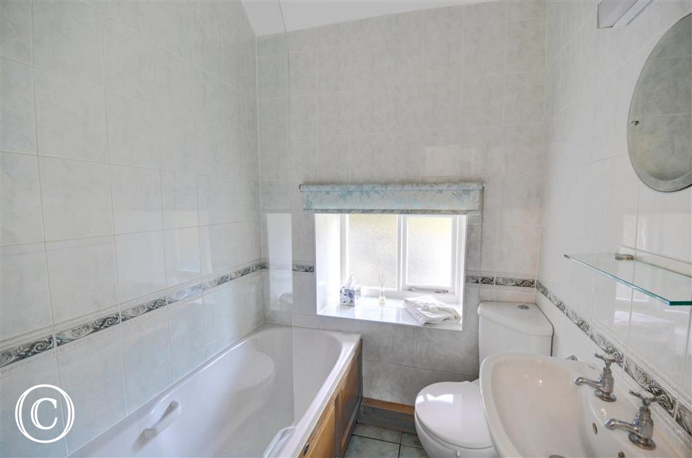 Light and bright bathroom with shower