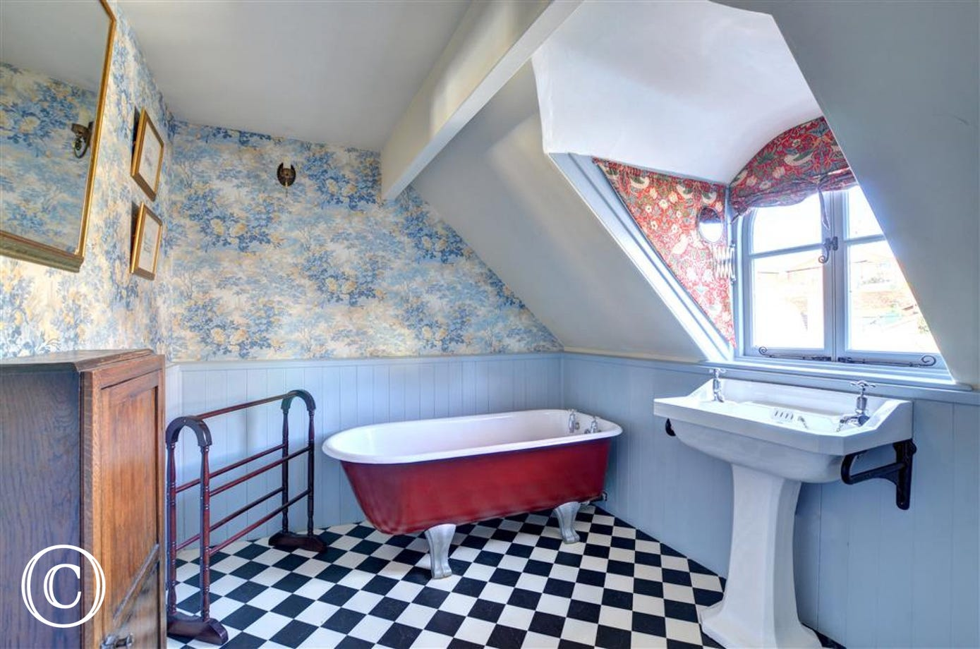 Characterful bathroom with roll-top bath.