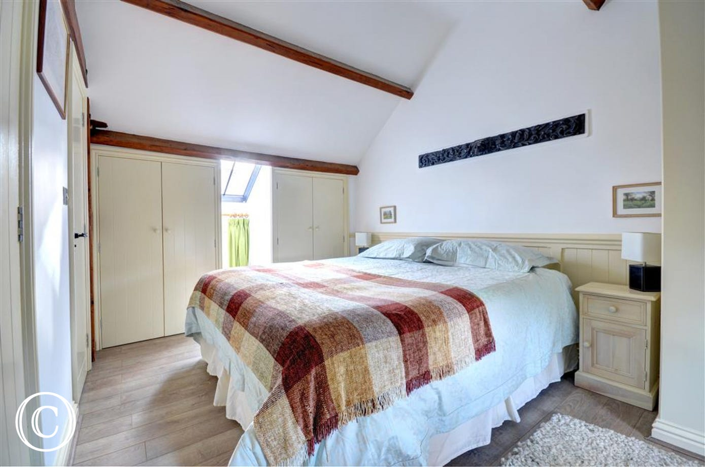 Lovely beamed ceilings and a king-size bed.