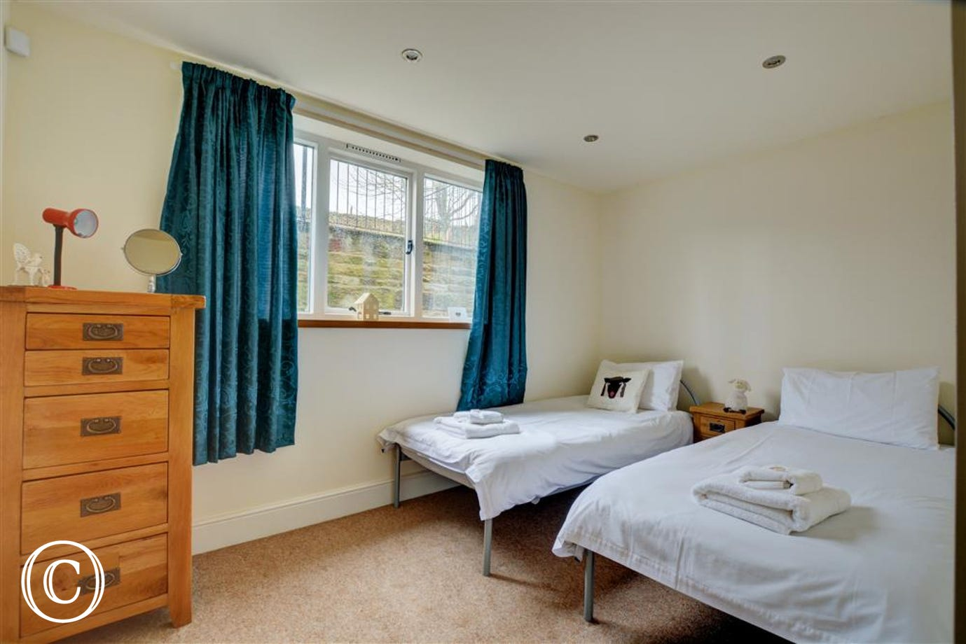 Twin bedroom 4, with garden views to the rear of the property.