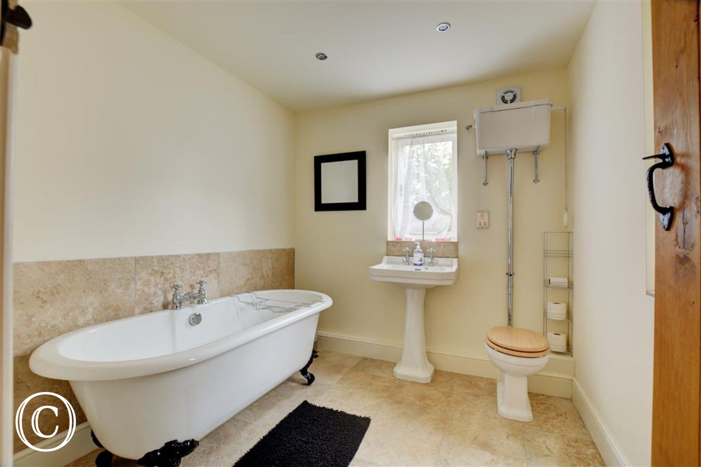 House bathroom with roll top bath and underfloor heating.