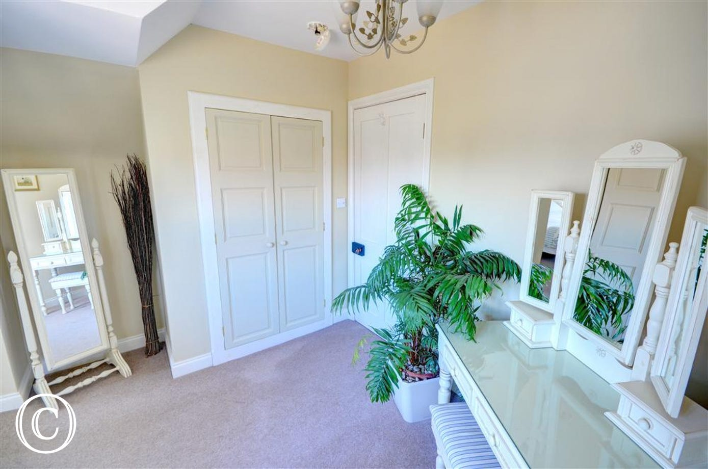 There is a spacious wardrobe, dressing table and a large mirror in the Dressing Room.