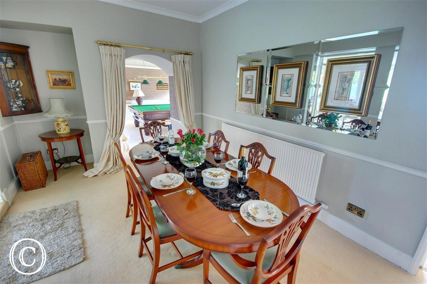 Spacious Dining Room in the centre of the household. This room leads to the Kitchen, Games Room and Lounge.