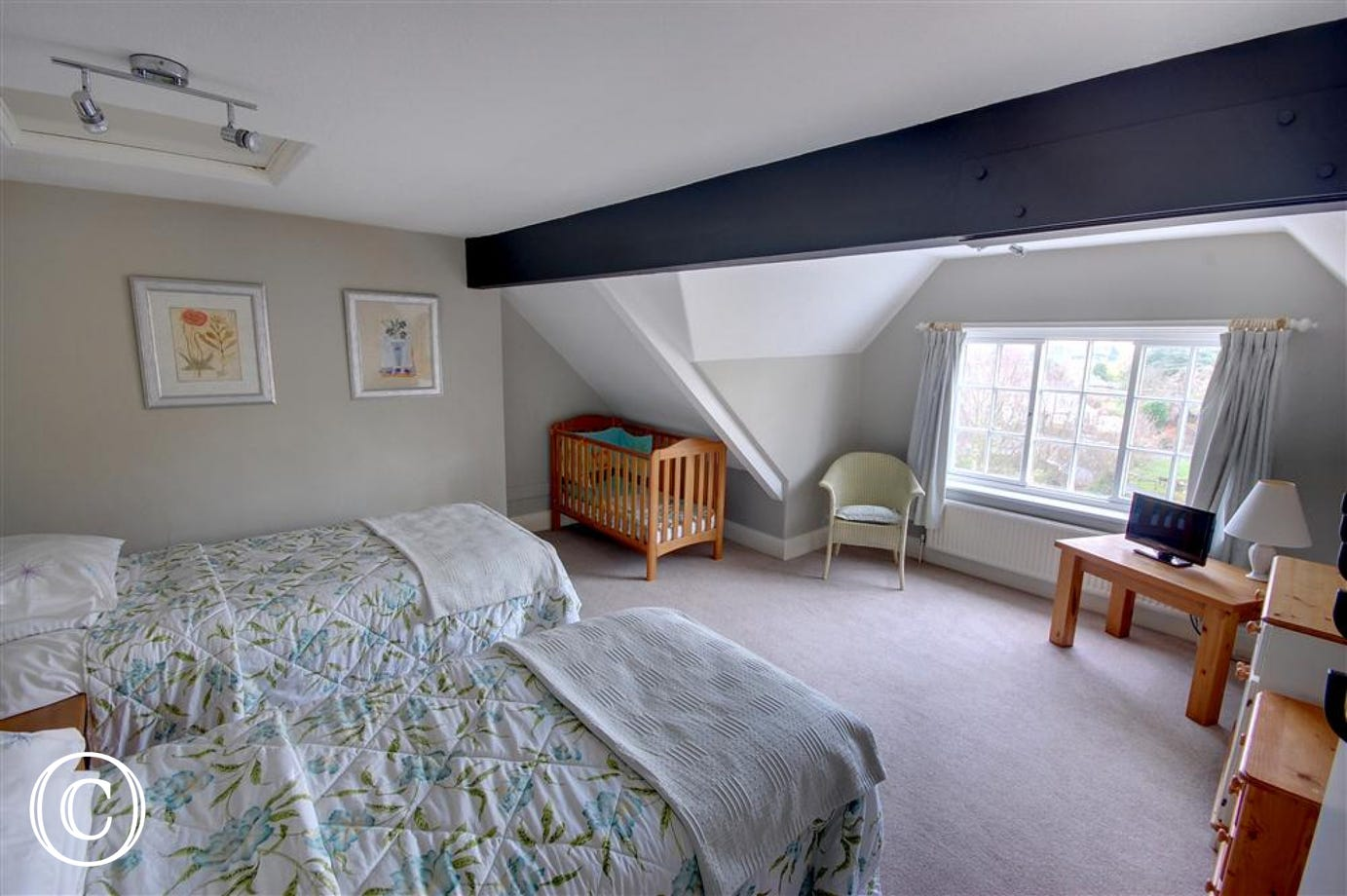 Spacious twin bedroom with single beds on the second floor. The window offers great views over the village of Scalby.