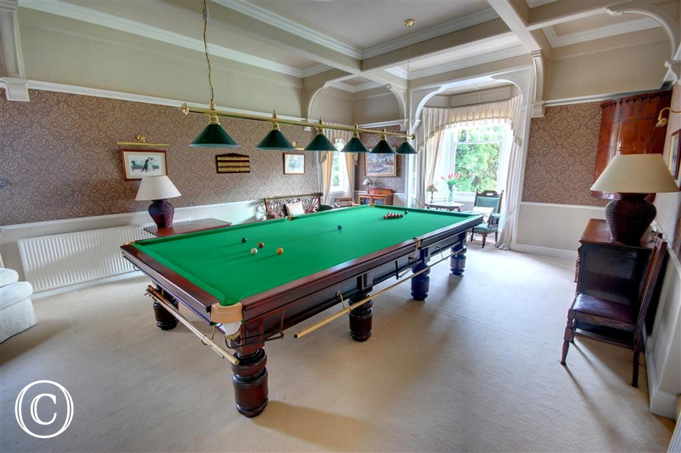 The spacious Games Room adjoins the Lounge and Dining Room.