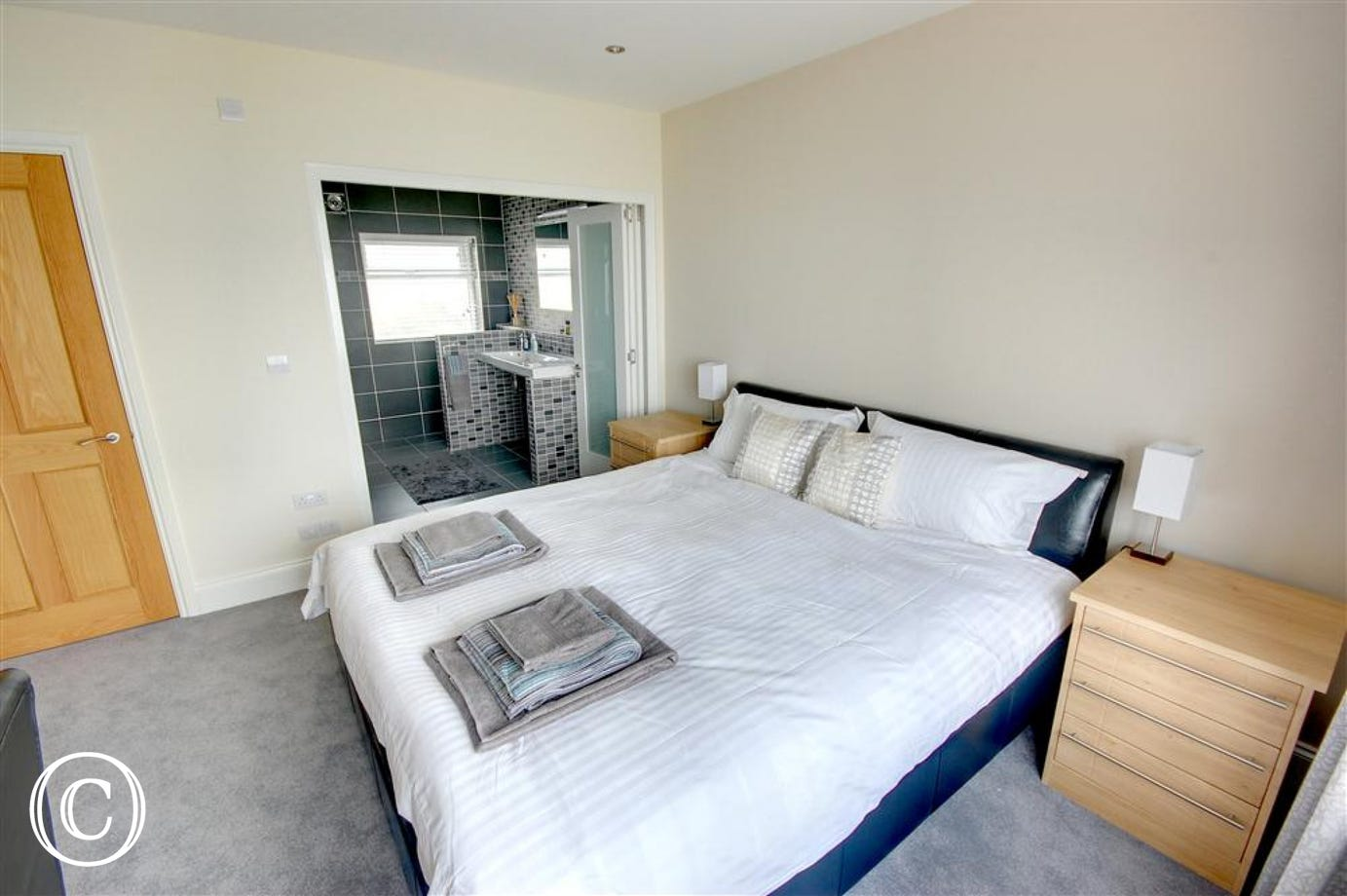 Master Bedroom which has its own en-suite with sliding doors.