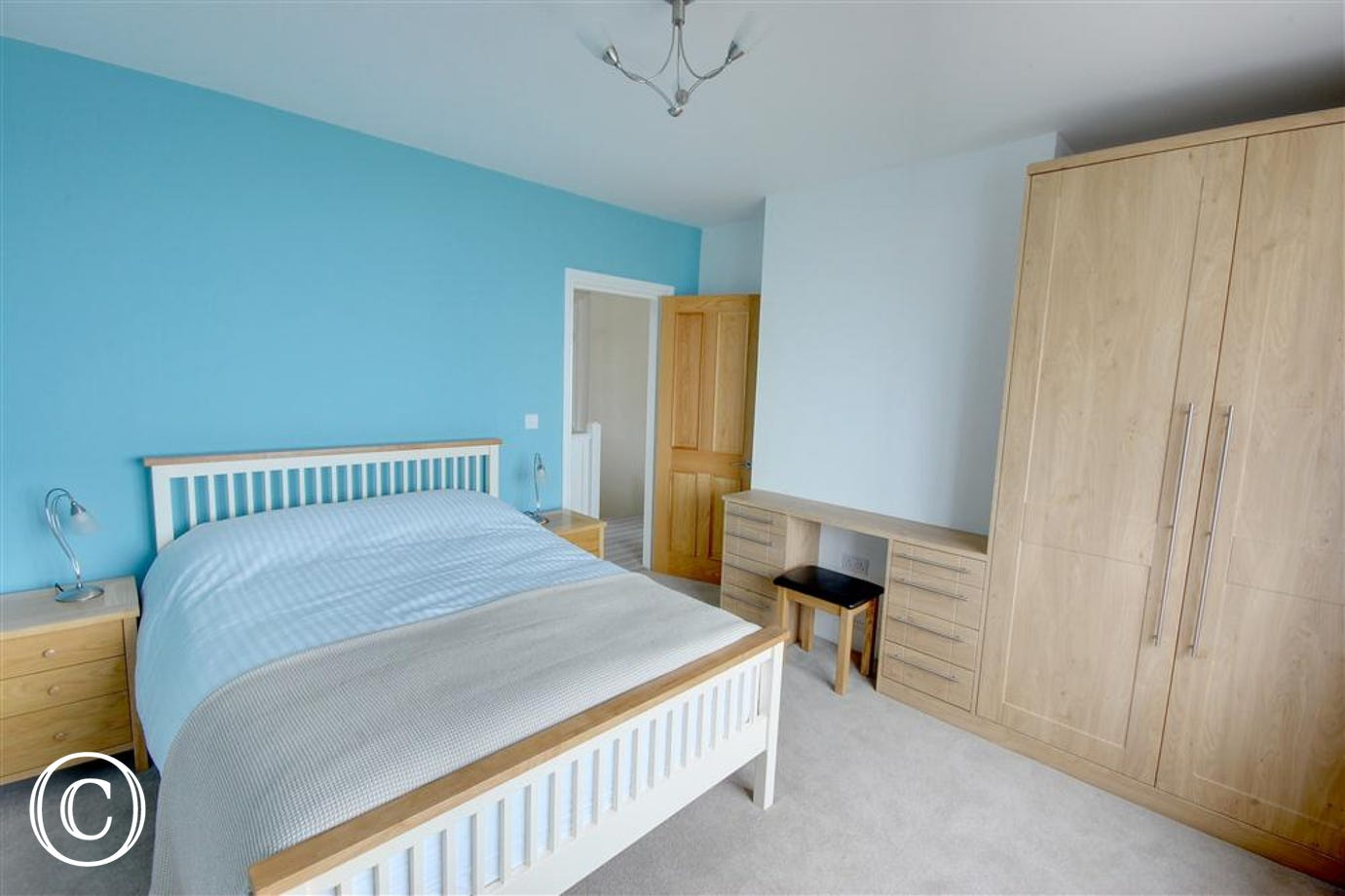 Spacious second double bedroom with plenty of storage in the fitted units.