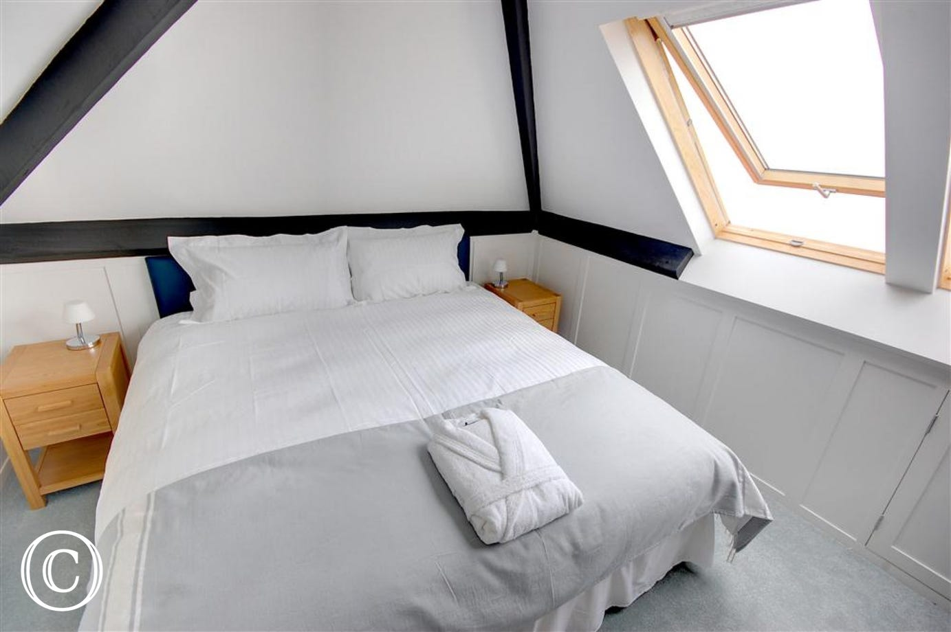 This top floor bedroom can either be made up as a double or a twin room with the zip and link beds.