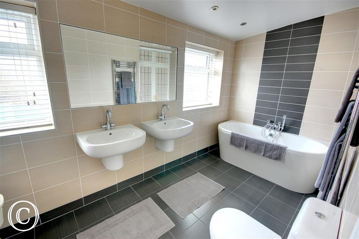 The family bathroom is very spacious and even offers the luxury of two washbasins.
