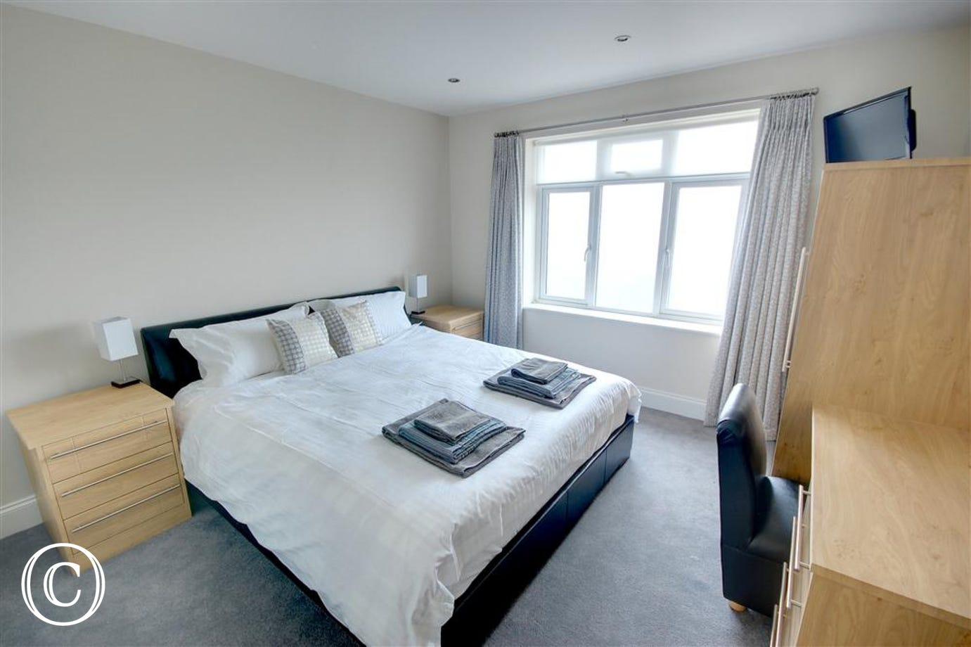 Large king-sized bed and high quality fitted furniture make this an attractive Master Bedroom.