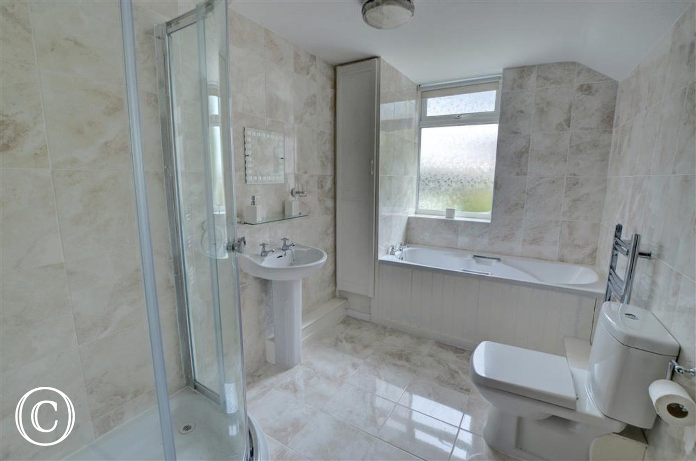 There is a large family bathroom with bath and separate shower.