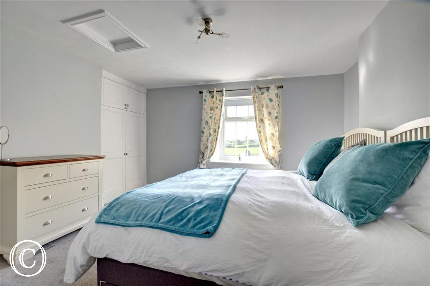 The master bedroom has a super king or twin beds.