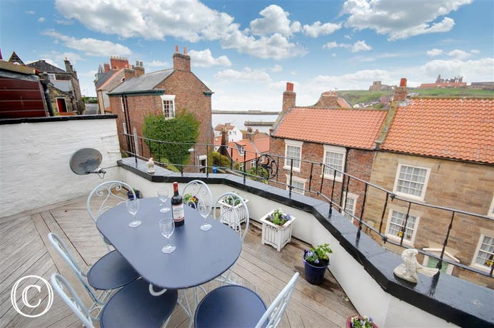 The Roof Terrace is accessed from the second floor bedroom. The patio furniture is perfect for sitting out and relaxing on a warm Summer's eve.