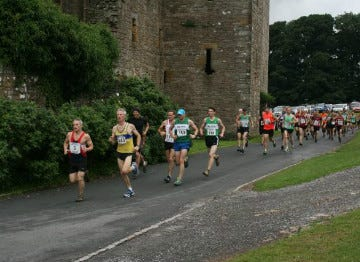 image of runners on the james herriot trail