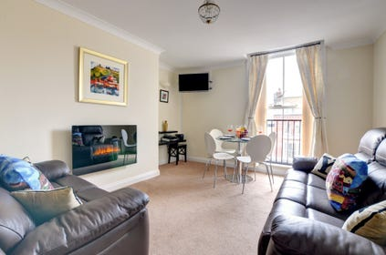 There is a spacious open plan lounge/diner with adjoining kitchen.