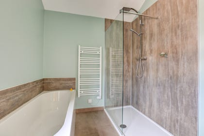 Bathroom with large bath and separate rainfall shower