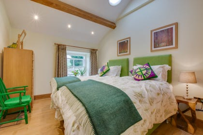 Twin bedroom with Zip & Link beds, beamed ceiling and views over glorious Swaledale