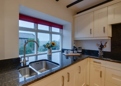 Well equipped kitchen with views down the valley