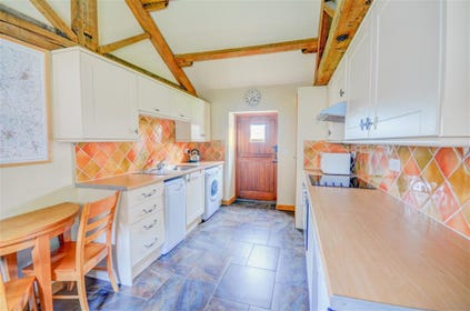 Well equipped kitchen with vaulted ceiling.