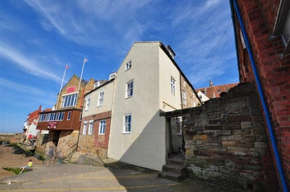 The property itself is located at the end of a small terrace which looks straight over the harbour and towards Whitby's west side.