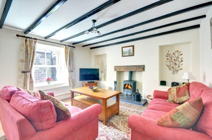 The Lounge is cosy and characterful with its beamed ceiling and woodburning stove.
