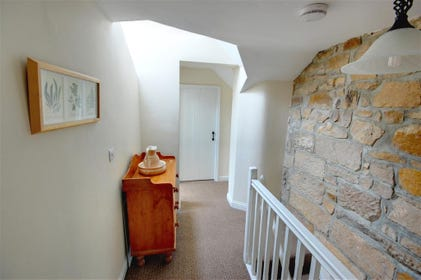 The Landing area and stairs also retain plenty of character with the original stone wall.