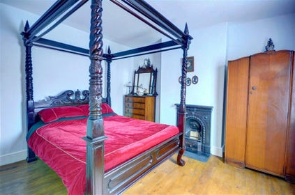 Master bedroom with grand four poster bed.