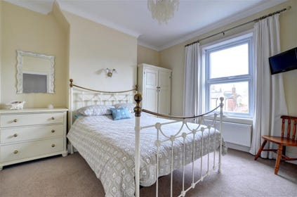 Characterful Bedroom with king-sized bed.
