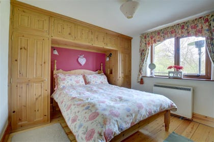 -Master bedroom with views of the garden.