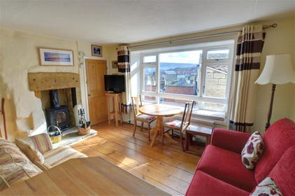 Cosy Lounge with wood-burning stove and fantastic views down towards the Bay.
