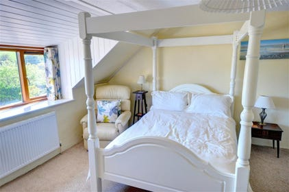 First floor double Bedroom with four-poster bed.