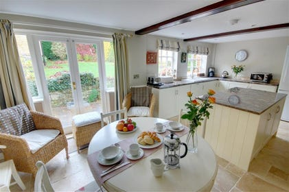 Open plan Kitchen and breakfast table area. Granite worktops add to this property's luxurious appeal.