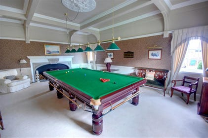 Games Room with full sized Snooker table. There is also a feature fireplace in this room along with some comfortable seating.