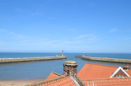 Fantastic views across the Harbour entrance and the Tate Hill sands from the top floor of the property.