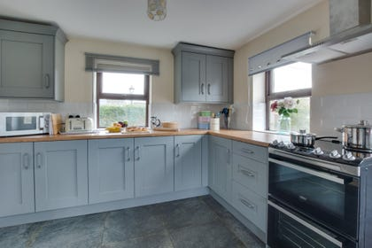 A light and airy kitchen which has been well stocked up. Perfect for making some home culinary delights.