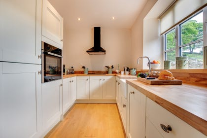 Well equipped kitchen with countryside views