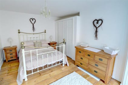 Double bedroom has good quality furnishings and fabrics.