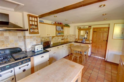 Spacious country-style Kitchen which includes a large Range cooker.