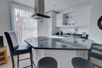 Open plan, well equipped kitchen area.