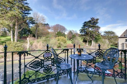 Balcony with bistro table for two and views over Pannett Park.