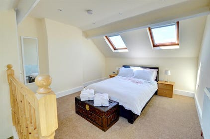 Spacious, light and airy master bedroom.