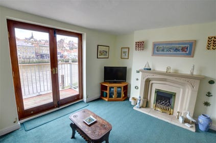 French doors in the Lounge open up onto the Balcony which directly overlooks onto the River Esk and Whitby's West side.