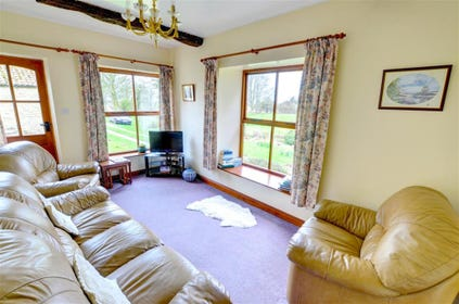 Lovely bright lounge with amazing country views towards North York Moors and Rosedale Abbey.